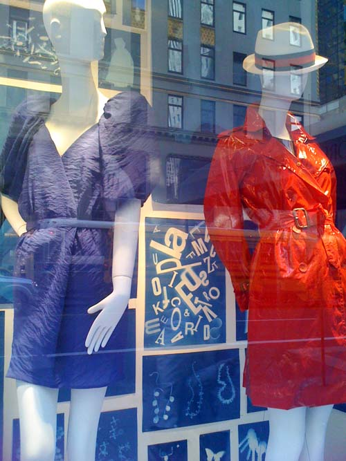 As I look at Window Design and Sunprints, a Model on her cellphone talks about the red raincoat