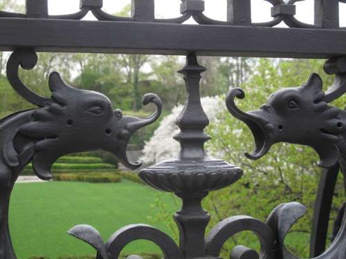 The Wrought Iron Gate's Gargoyles fiercely guard the beauty within.
